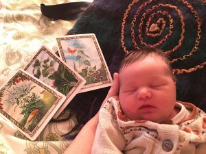 baby, drum and tarot cards
