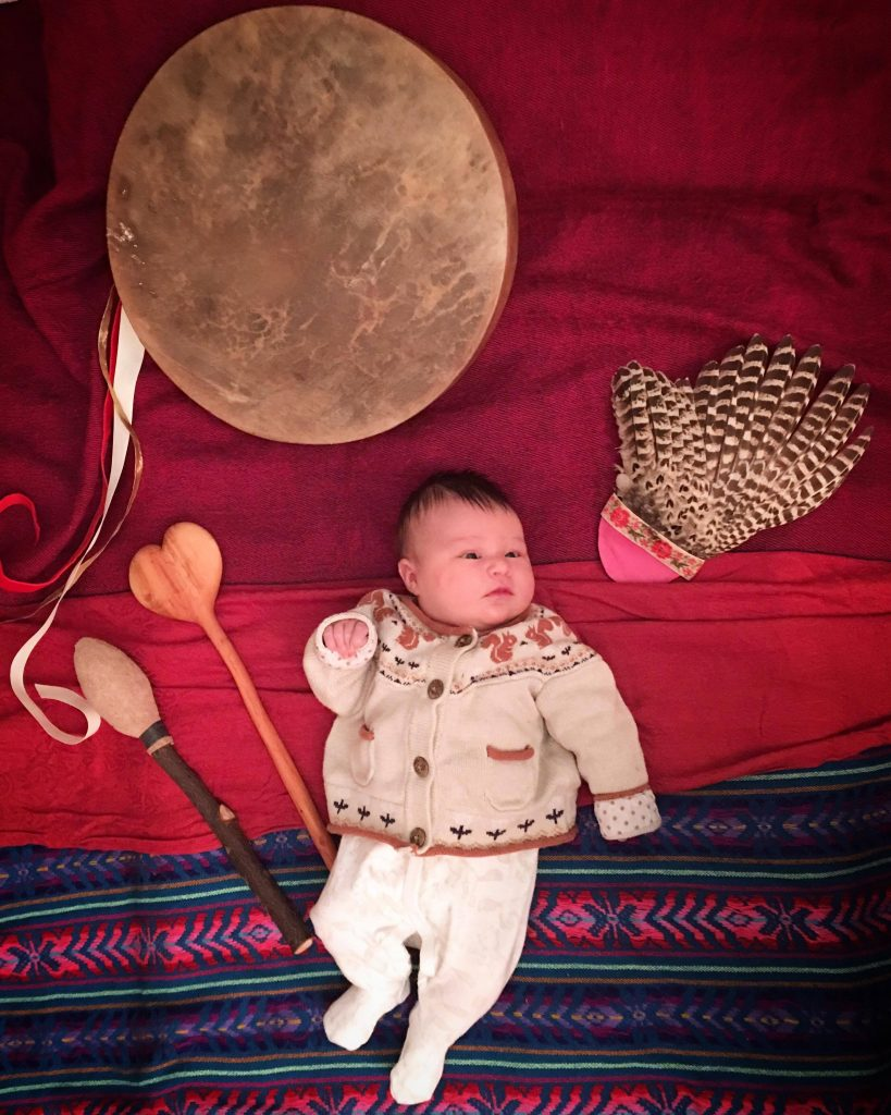 Closing Ceremony - baby, feather and drum